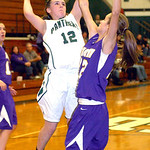 EC's #12 Riley Schill shoots past Avon's #12 Regan Betts.