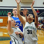 EC Karissa McGrath, right, and Shannon Hopkins go up for rebound, Bay 24 is Nora Ziebarth.  Steve Manehim