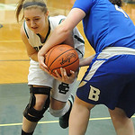 EC Erin Herschelman and Bay Ellen Hanna fight for the ball in first half Feb. 13.  Steve Manheim