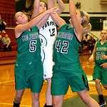 EC's #12 Riley Schill shoots past Columbia's #5 Jenna Guth and #42 Kaley Marshall.