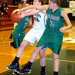 EC's #22 Shannon Hopkins fights Columbia's #24 Shelby Stedronsky and #3 Christine Lyzen for the ball.