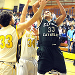 EC Ceeven Shelton puts up shot over Ridgeville 33 Dan Teitenberg and 34 Jacob Ruoff Dec. 18.  Steve Manheim