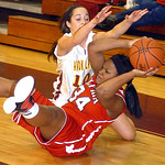 Elyria's #34 Alexis Roseboro throws the ball back in past Avon Lake's #10 Kay Butrey.