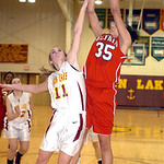 Elyria's #35 Alexis Middlebrooks shoots past Avon Lake's #11 Anelise Kollias.