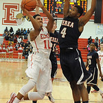 Elyria Isaiah Walton shot over Berea Devin Posey in second half Dec. 4.  Steve Manheim