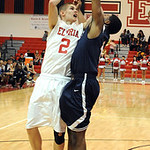 Elyria Kody Bender shoots ove Berea Devin Posey in second half Oct. 4.  Steve Manheim