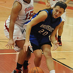 Brunswick Melissa Movens and Elyria Mary Jones chase a loose ball Dec. 12.  Steve Manheim
