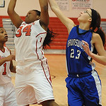Elyria Alexis Roseboro grabs a rebound from Brunswick Monica Wasson in first half Dec. 12.  Steve Manheim