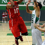 Elyria Isaiah Walton puts in a shot over Mayfield Matt FLowers Dec.13.  steve Manheim