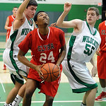 Elyria AJ Johnson is fouled going to hoop by Mayfield Ricky Tagg, left, and Mike Galloway Dec. 13.  Steve Manheim