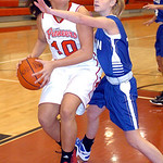 Elyria's #10 Shayla Middlebrooks prepares to shoot past Midview's #11April Rieth.