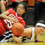 Elyria's Jocelyn Spraggins, left, collides with Heather Mueller of Olmsted Falls while chasing a loose ball in the fourth quarter. DAVID RICHARD / CHRONICLE