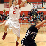 Elyria Kody Bender takes shot over Valley Forge Robert Schmidt Dec. 18.  Steve Manheim
