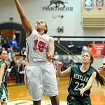 Elyria  Mary Jones goes to hoop by Westlake Allison Collins in overtime of Div. I sectional Feb. 20.  Steve Manheim