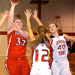 Firelands' #32 Destiny Samples shoots past Lutheran West's #12 Lindsey Tomola and #40 Amanda Stephens.