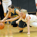Amherst's Sara Elliott battles for a loose ball with Wadsworth's Hannah Centea in the fourth quarter of the Division I District semi-final game Tuesday night at Medina High School. JUDD SMER …