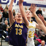 ANNA NORRIS/CHRONICLE Avon's Allie Bjorn puts up a shot against Wooster's Erin Daugherty in the first half of the Division I district semi-final game at Valley Forge High School Monday night …