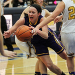 ANNA NORRIS/CHRONICLE Avon's Allie Bjorn is fouled by a Wooster defender on the way to the basket in the first half of the Division I district semi-final game at Valley Forge High School Mon …