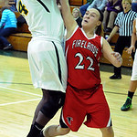 Firelands 22 Kaitlyn Michener tries to grab ball away from Amherst Brooke Wallace Nov. 25.    Steve Manheim