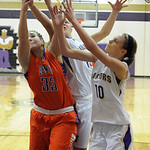 Vermilion's Caitlyn Schnur, right, and Jen Kovarik fight for a rebound with Edison's Gabby Stoll. STEVE MANHEIM/CHRONICLE