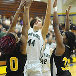 Elyria Catholic's Jessie Lee shoots over Beachwood's Aryana Jackson and Christina Oden. STEVE MANHEIM/CHRONICLE