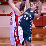 Lutheran West's Jessica Gavlak and Elyria Catholic's Margot Novak fight for the ball.  LINDA MURPHY/CHRONICLE