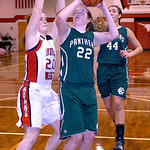 Elyria Catholic's Nora Hopkins tries to shoot past Lutheran West's Carey Smith.  LINDA MURPHY/CHRONICLE