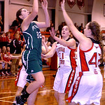 Elyria Catholic's Becky Horvath shoots past Lutheran West's Johanna Ragland, center, and Jessica Gavlak.  LINDA MURPHY/CHRONICLE