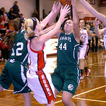 Elyria Catholic's Jessie Lee, right, and Riley Schill fight Lutheran West's Kimmy Evans for the rebound. LINDA MURPHY/CHRONICLE