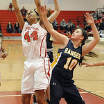 Elyria's Mariah Johnson grabs a rebound over North Rigeville's Kelly Wisniewksi. STEVE MANHEIM/CHRONICLE
