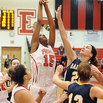 Elyria's CiCi Mcintosh has her shot blocked by North Ridgeville's Isabella Pecchia. Also pictured are Elyria's Sierra White and North Ridgeville's Leah Lindak. STEVE MANHEIM/CHRONICLE