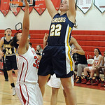 North Ridgeville's Isabella Pecchia hits a shot and is fouled by Elyria's Sierra White. STEVE MANHEIM/CHRONICLE