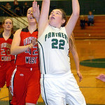 Elyria Catholic's Nora Hopkins tries to shoot past Lutheran West's Kassey Wilkens. LINDA MURPHY/CHRONICLE