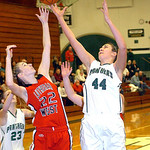 Lutheran West's Olivia Vasiloff and Elyria Catholic's Jessie Lee fight for the rebound. LINDA MURPHY/CHRONICLE
