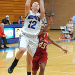 Midview's Carrie Carlson drives to the basket past Elyria's Kelsey Brooks. STEVE MANHEIM/CHRONICLE