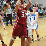 Elyria's Sierra White is fouled by Midview's Shelby Plas. STEVE MANHEIM/CHRONICLE