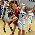 Elyria's Dierra Hammons goes up for a shot against Midview's Molly Linn, left, and Shelby Plas. STEVE MANHEIM/CHRONICLE