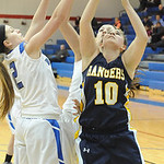 North Ridgeville's Kelly Wisniewski and Bay's Aubrey Rohlke go up for rebound. STEVE MANHEIM/CHRONICLE