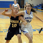 North Ridgeville's Kelly Wisniewski and Bay's Nora Ziebarth fight for a loose ball. STEVE MANHEIM/CHRONICLE