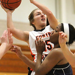 ANNA NORRIS/CHRONICLE North Olmsted's Sarah Lyons muscles up a shot over Olmsted Falls' Savanajh Black in the first half Saturday afternoon at North Olmsted High School.