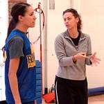 Lake Ridge's coach Lisa Medvetz coaches Sydney Clark during a drill.