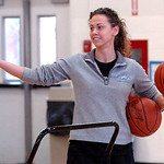 Lake Ridge girls basketball coach Lisa Medvetz prepares to toss balls to the girls for drills.