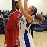 Lake Ridge Selena Benz goes to basket over JFK Daijha Truett Nov. 27.  Steve Manheim