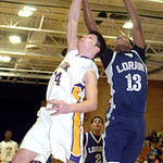 Lorain's #13 Devon Andrews and Avon's #14 Zack Torbert fight for the rebound.