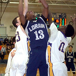 Lorain's #13 Devon Andrews has to work to shoot past Avon's #23 Jordan Lawrence and #12 Cordell Winters.