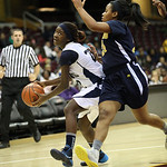 Lorain's Tremia Blair keeps her eye on the basket while Euclid's Raquel Latimer defends. RAY RIEDEL/CHRONICLE