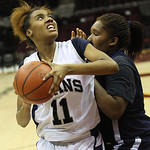 Lorain's Malaya Simmons gets past Euclid's Raquel Latimer at the baseline. RAY RIEDEL/CHRONICLE