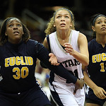 Lorain's Destiny Wilson, center, battles Satari Blade, left, and Alexis Hoxie for the rebound. RAY RIEDEL/CHRONICLE