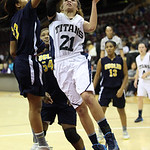 Lorain's Destiny Wilson drives on Euclid's Tomariah Whitner. RAY RIEDEL/CHRONICLE
