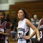 Lorain's Destiny Wilson is between Maple Heights Danielle Robinson (left) and Piereiona Stewart (right) watching the first of two foul shots. photo by Ray Riedel